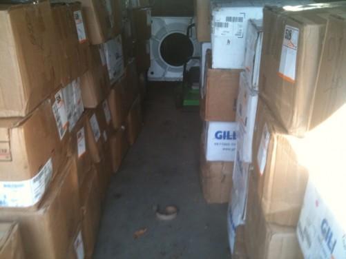 boxes of merch hallway